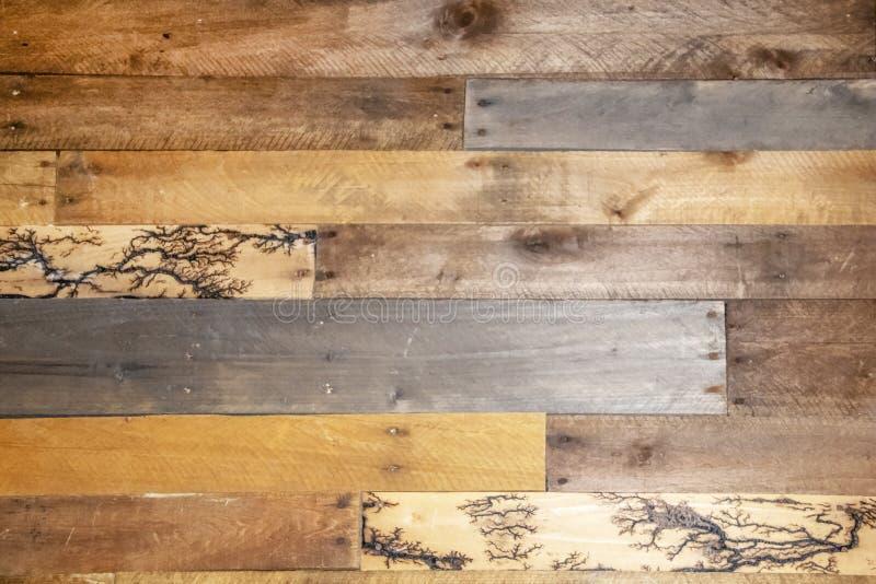 Background - repurposed wood planks- a few have unusual fractal lightning high voltage lichtenberg wood burning patterns.  stock image