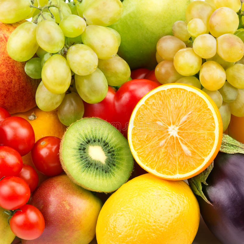 Background of ripe fruit and vegetables. Bright background of ripe fruit and vegetables stock photography