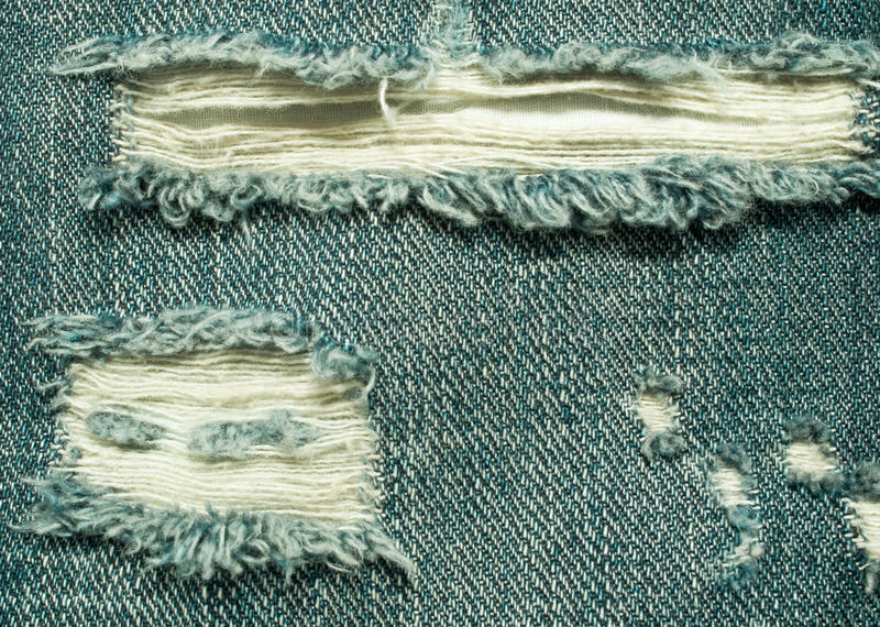 Background of the ripped jeans royalty free stock images