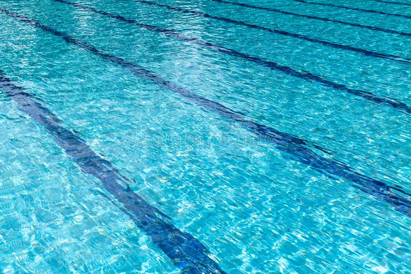 Background of rippled pattern of clean water in a blue swimming pool. Abstract, aqua, bright, clear, cool, fresh, light, liquid, nature, ocean, pure stock image