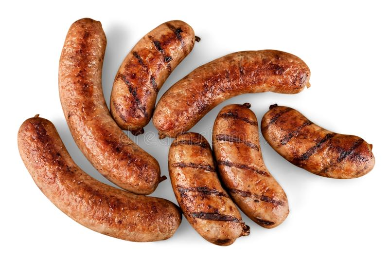 Roasted sausages on white background royalty free stock photography