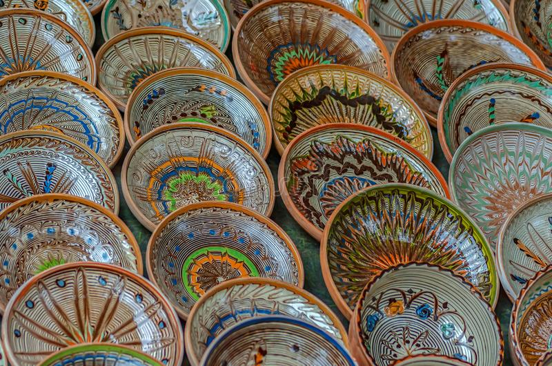 Background with Romanian traditional ceramic in the plates form. Painted with specific patterns from Horezu area stock images