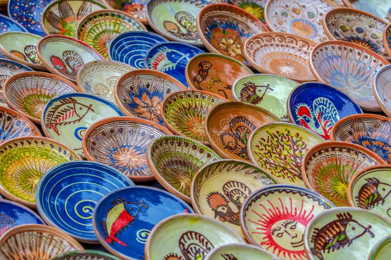 Background with Romanian traditional ceramic in the plates form. Painted with specific patterns from Horezu area royalty free stock images