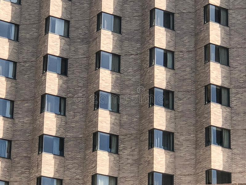 Rows of windows on brick building royalty free stock photo