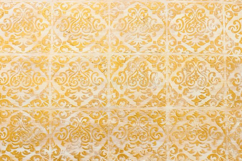 Background of royal gold wooden vintage background with floral emboss details.  stock photo