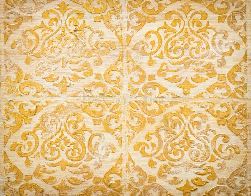 Background of royal gold wooden vintage background with floral emboss details.  royalty free stock photo