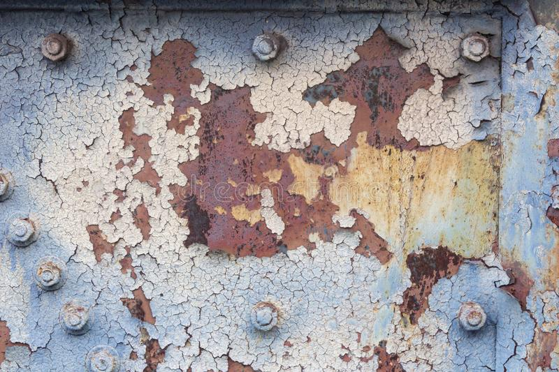 Background of rusted metal with peeling paint, nuts and bolts, copy space. Horizontal aspect stock photos