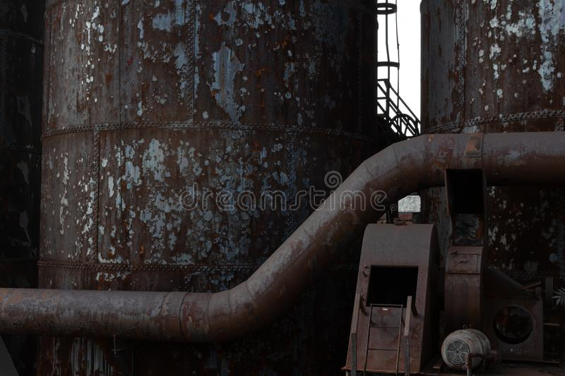 Background of rusting metal industrial shapes and textures, tubes and columns. Horizontal aspect royalty free stock photos