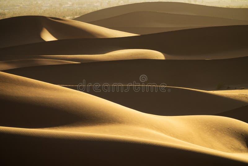 Background with of sandy dunes in desert. Background with beautiful structures of sandy dunes in the Sahara desert stock image
