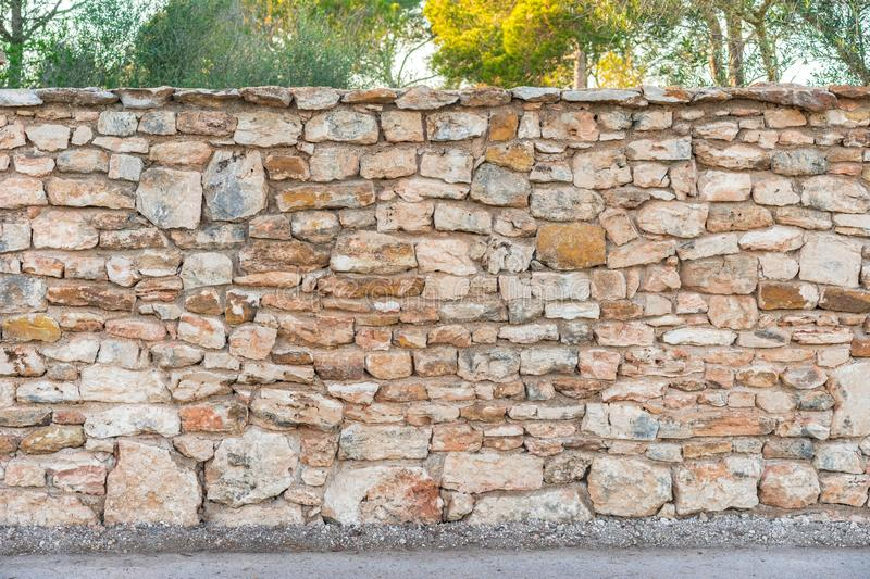 Rustic old garden stone wall background texture with sidewalk stock photos
