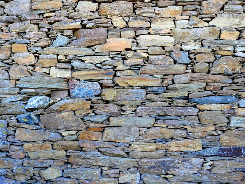 Background with schist stone wall patterns. stock image