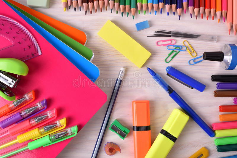 Background with school or office material top view. Background with school or office material. With checkered sheets notebook and space for title. Top view stock photo
