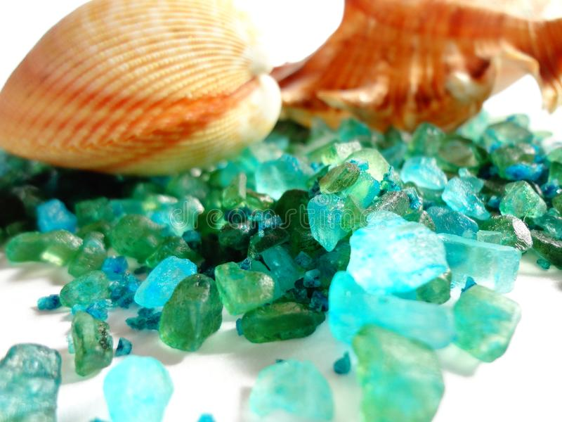 Background with sea shells and sea salt of blue-green color, creating a sense of sea water. royalty free stock photography