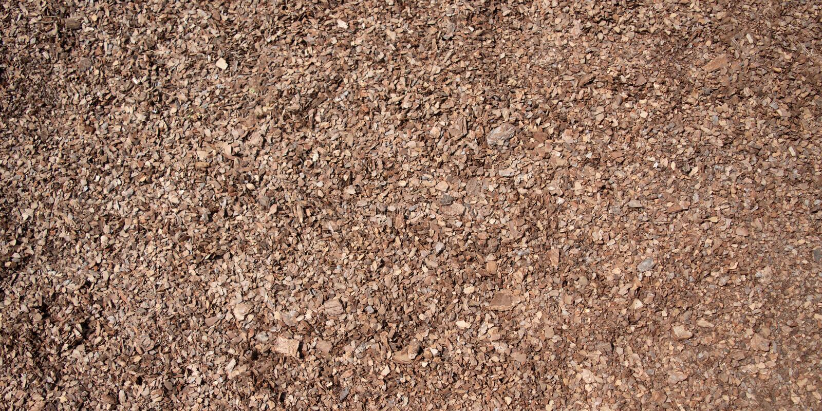 Background of seamless tiling wood chips. Used for safety in toddlers playgrounds stock images