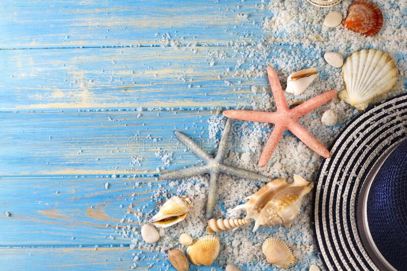 Background of seashells, starfishes and Beach hat stock photos