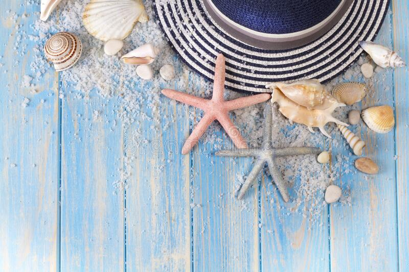 Background of seashells, starfishes and Beach hat stock photography