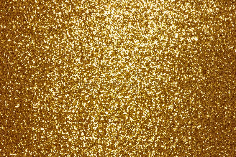 Sparkling golden sequin textile background. Background sequin. sequin BACKGROUND. glitter surfactant. Holiday abstract glitter background with blinking lights stock image