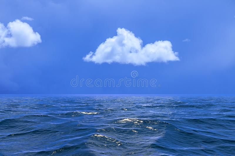 Background of sky with a single cloud reflected in water or ocea royalty free stock photography