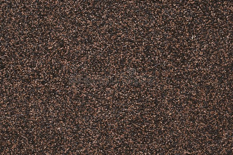 Background of small black pebbles. Modern paper design. Abstract grains pattern. Brown mottled texture of wall. Stone motley surfa stock photos