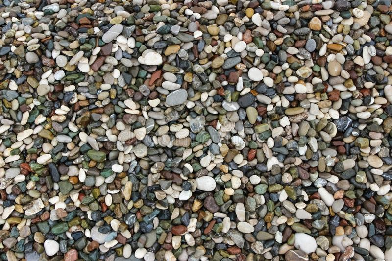 Background of small stones pebble beach stock images