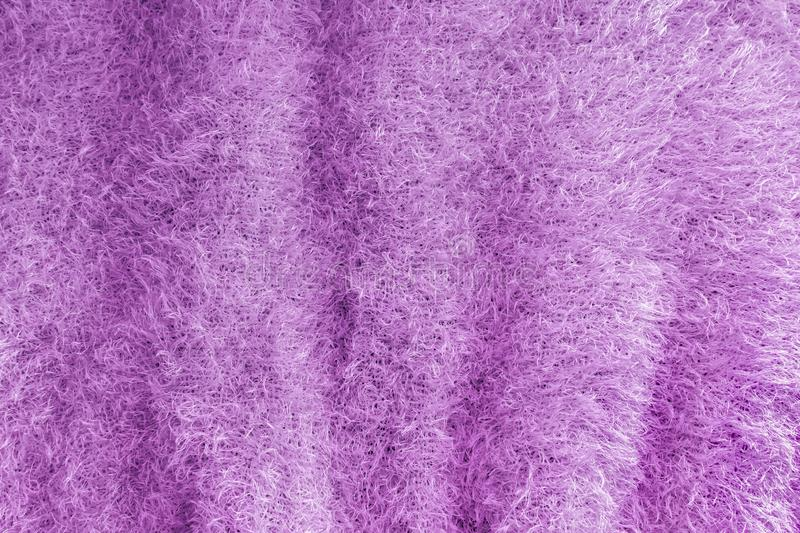 Background of soft, fluffy knit fabric. Lilac knitted texture.  stock photo