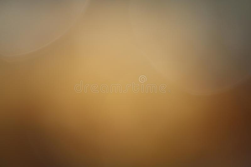 Background soft light blown gold blurry pastel color, Gold blown gradient graphic abstract art bright. The Background soft light blown gold blurry pastel color royalty free stock images