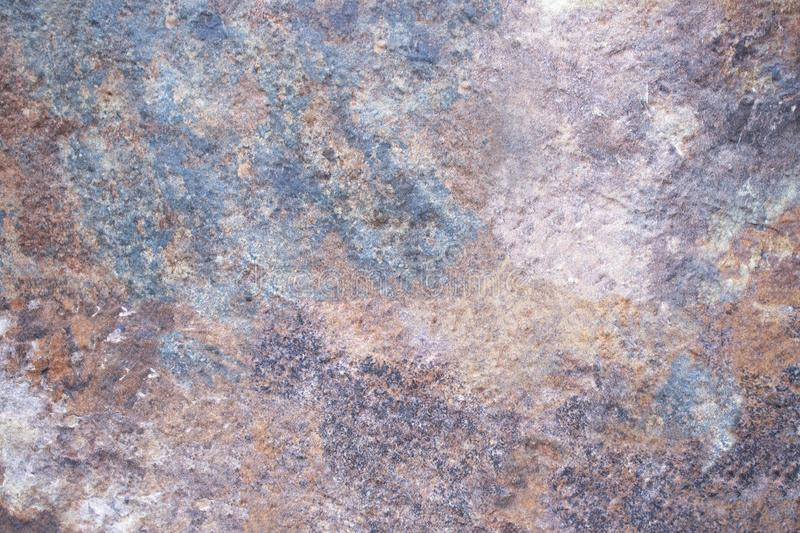 Background from a solid texture of notural stone. Background from a solid stone texture. Rust-like natural stone royalty free stock photo