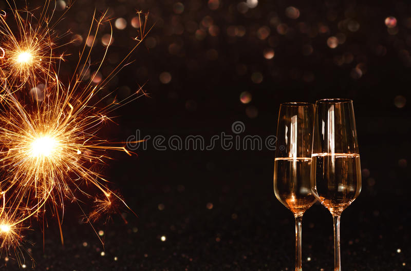 Background with sparkling miracle candle and champagne stock image