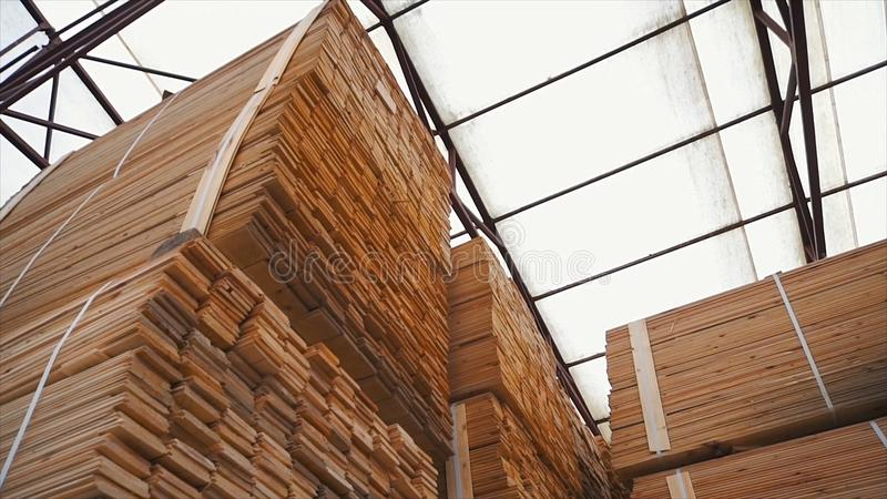 Background of the square ends of the wooden bars. Wood timber construction material for background and texture. close up royalty free stock photography
