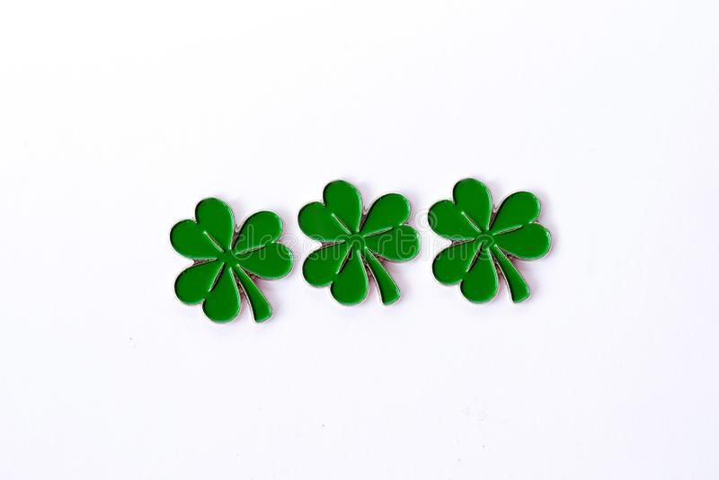 Background for St. Patrick`s day. for design with clover. Clover isolated on white background. Irish symbols of the holiday. Ther stock photography