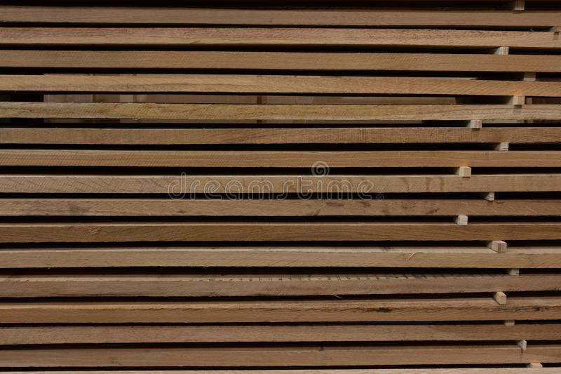 Background of a stack of wooden boards in storage stock photography