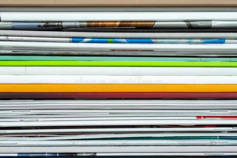 Background from stacked magazines, brochures, notebooks, catalogs.  royalty free stock image
