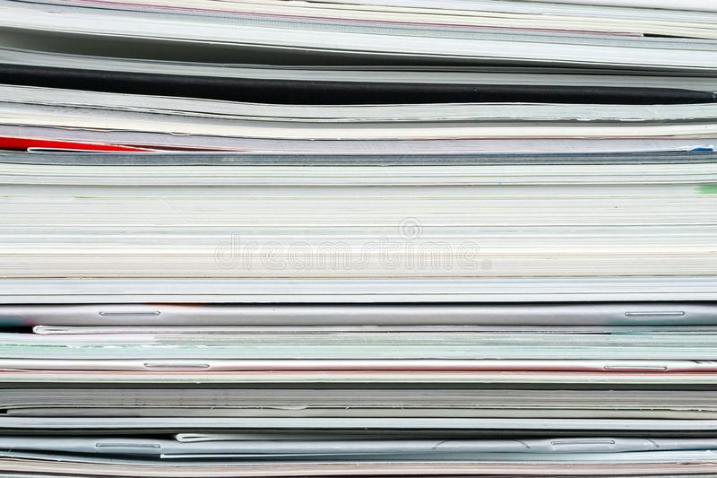 Background from stacked magazines, brochures, notebooks, catalogs.  stock image