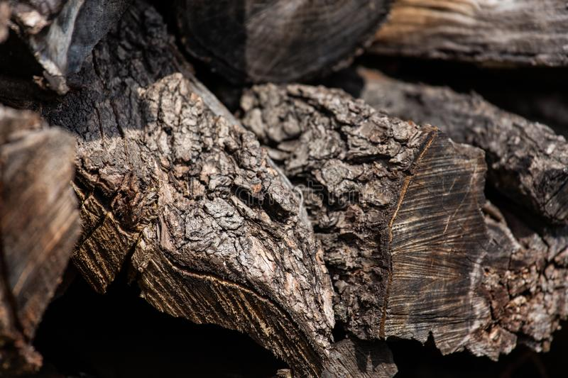 Background from stacked old brown stab wooden logs.  royalty free stock photography
