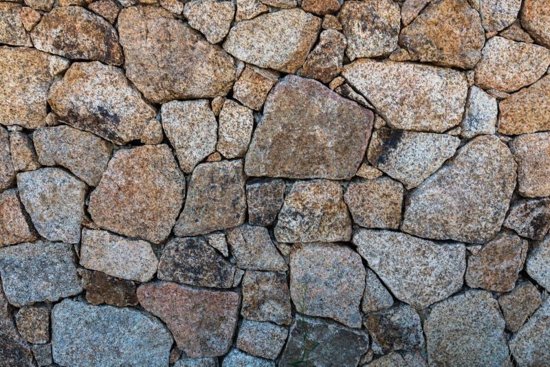 Background stone wall of granite stones. Horizontal orientation royalty free stock photo
