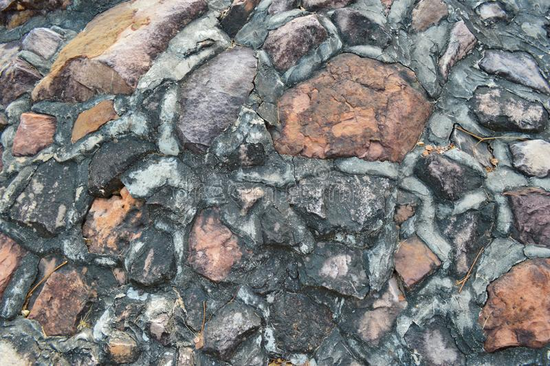 Cement clinker wall. Background of stone wallCement clinker stock photography