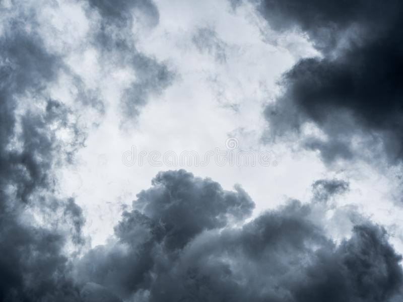 Dark storm clouds before rain. Background of storm clouds before a thunder-storm royalty free stock photography