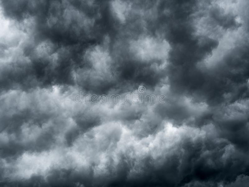 Dark storm clouds before rain. Background of storm clouds before a thunder-storm stock photo
