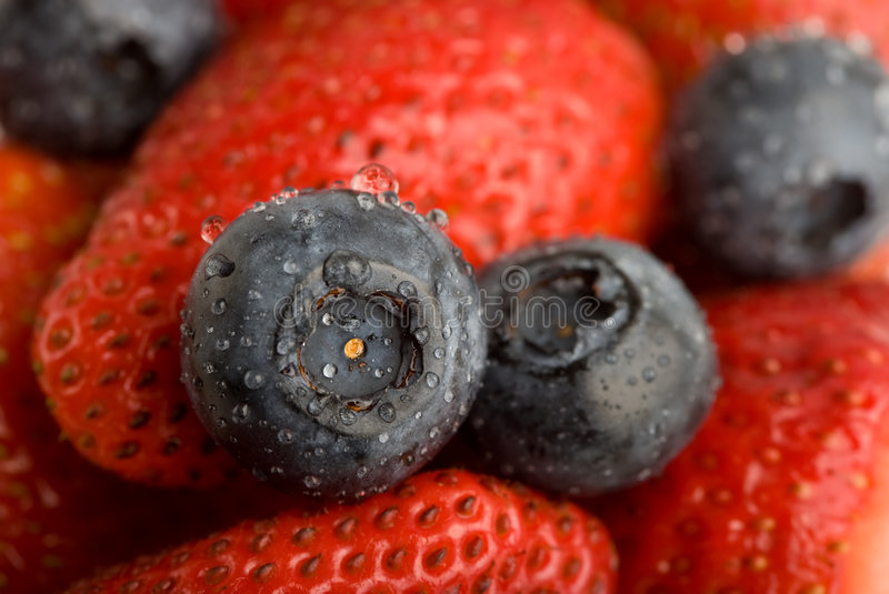 Background from Strawberries and blueberry stock images