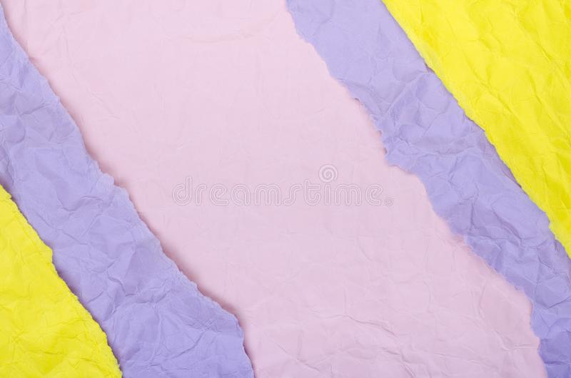 Background of strips of crumpled paper yellow purple and pink royalty free stock images