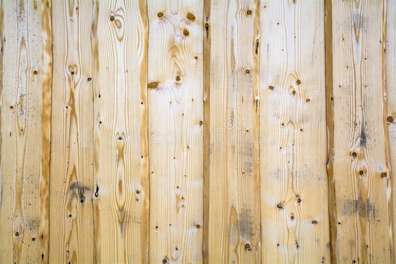 Vertical background of light spruce boards arranged vertically. Background structure of light spruce planks arranged vertically. Space for text royalty free stock photos