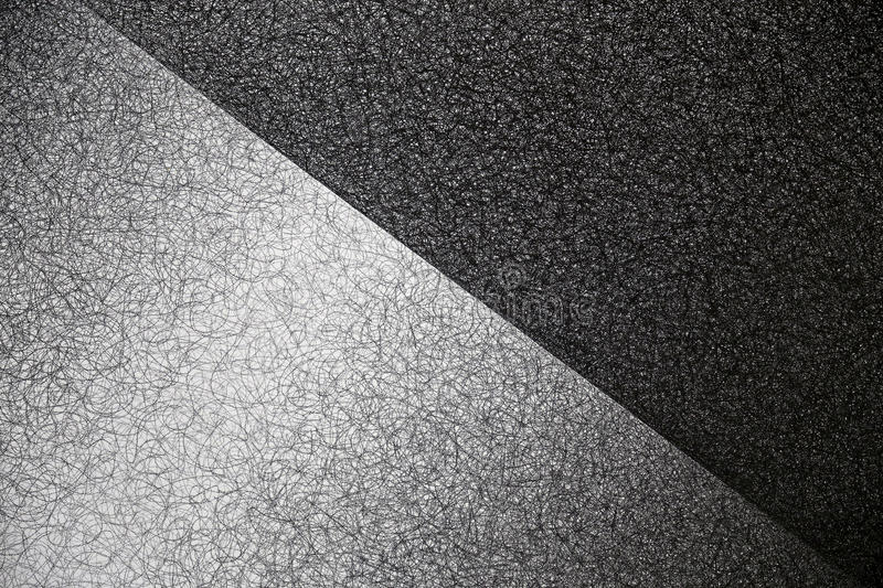 Background with structures in black and white. Diagonal field division with structure in black and white royalty free stock photography