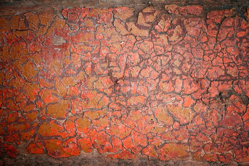 Background surface is red, terracotta with finely cracked paint, small cracks on the painted wall, craquelure. A background surface is red, terracotta with royalty free stock photography