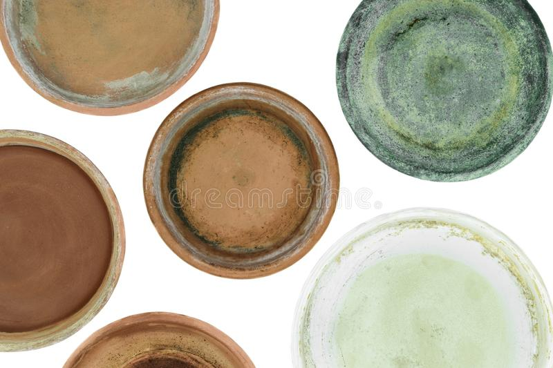Background surface of various colors and dirty clay plates for plants and isolated on white background.  royalty free stock photos