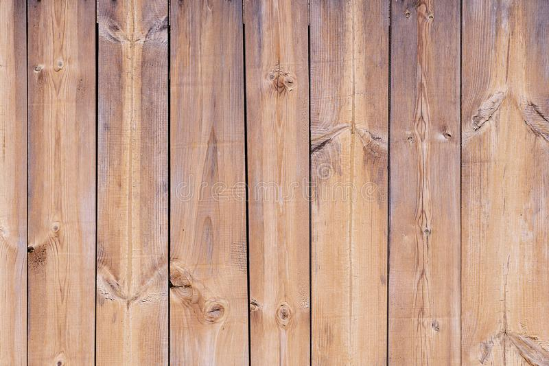Background table wooden free, without objects. The texture of the tree, the board is brown. Harvesting wood vertical dark. Boards stock photos
