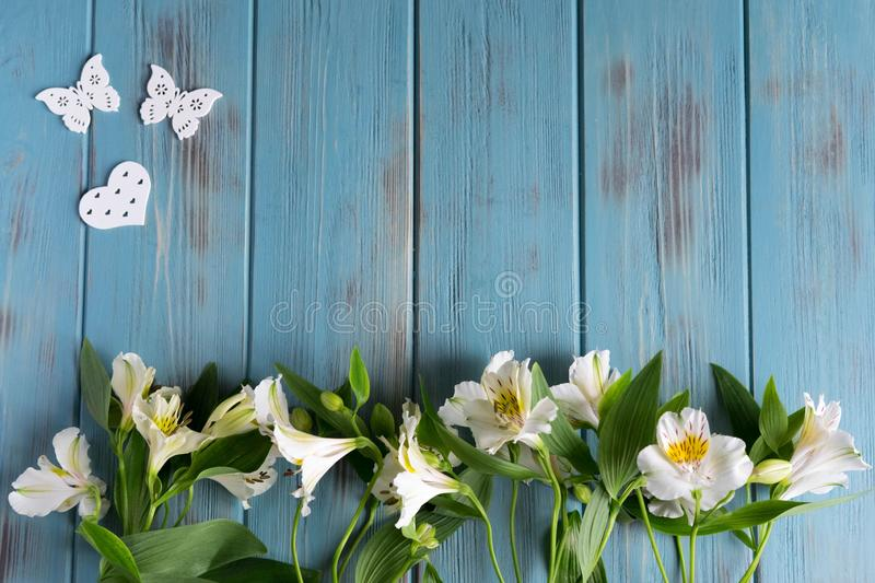 Background for text banner on a blue wooden background with white flowers and butterflies. Blank, frame for text. Greeting card. Design with flowers stock image