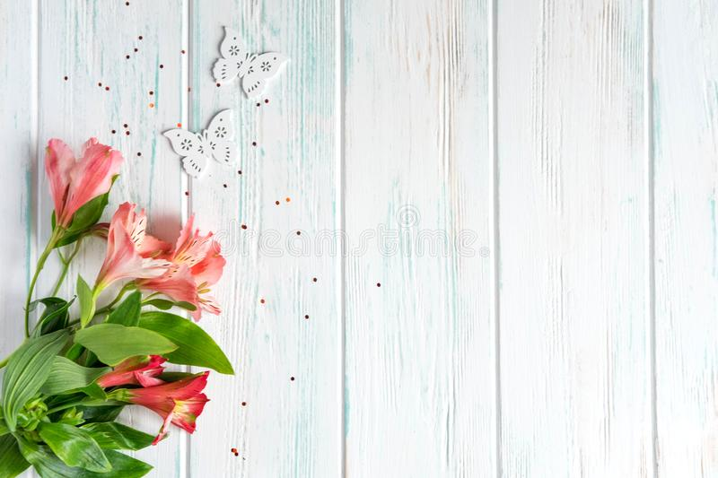 Background for text banner on a light wooden background with pink flowers and butterflies. Blank, frame for text. Greeting card. Design with flowers stock image