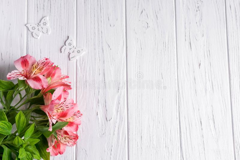 Background for text banner on a light wooden background with pink flowers and butterflies. Blank, frame for text. Greeting card. Design with flowers royalty free stock photo