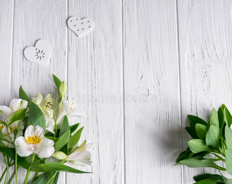 Background for text banner on a white wooden background with white flowers. Blank, frame for text. Greeting card design with. Flowers. alstroemeria on wooden royalty free stock photography