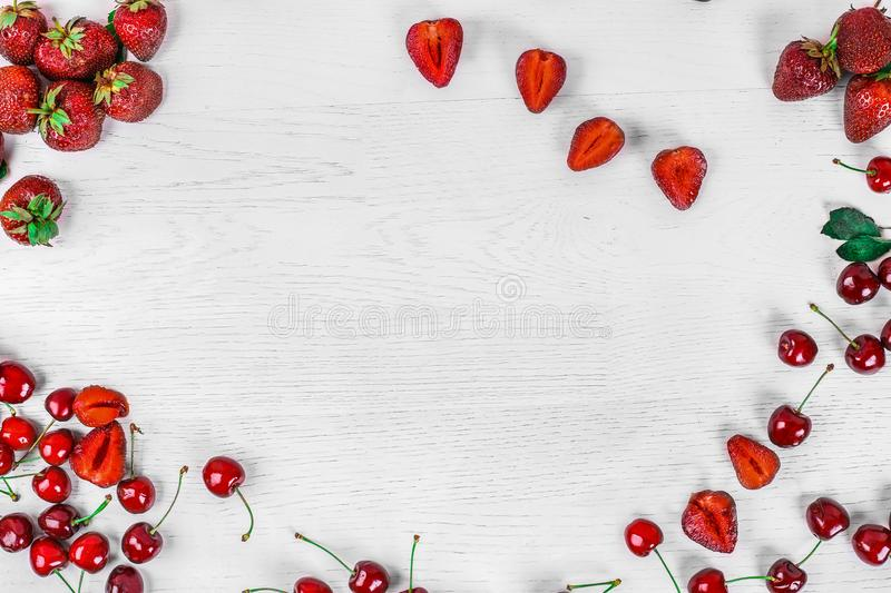 Background for text. Top view of strawberries and cherries. Summer food stock photos